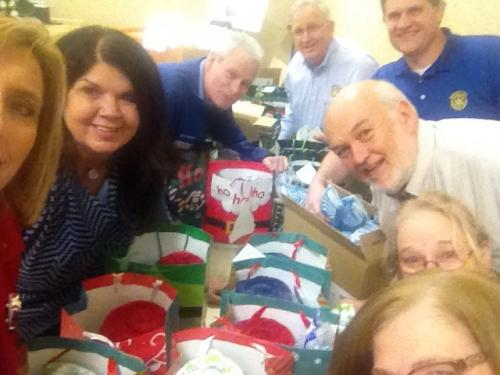 rotarians packing christmas gift for nursing home residentsjpg
